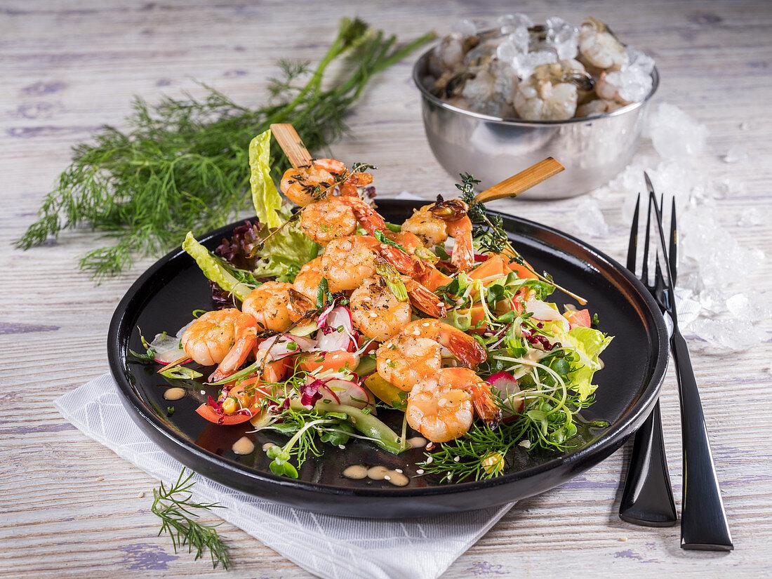Fried shrimp kebab on a colourful salad