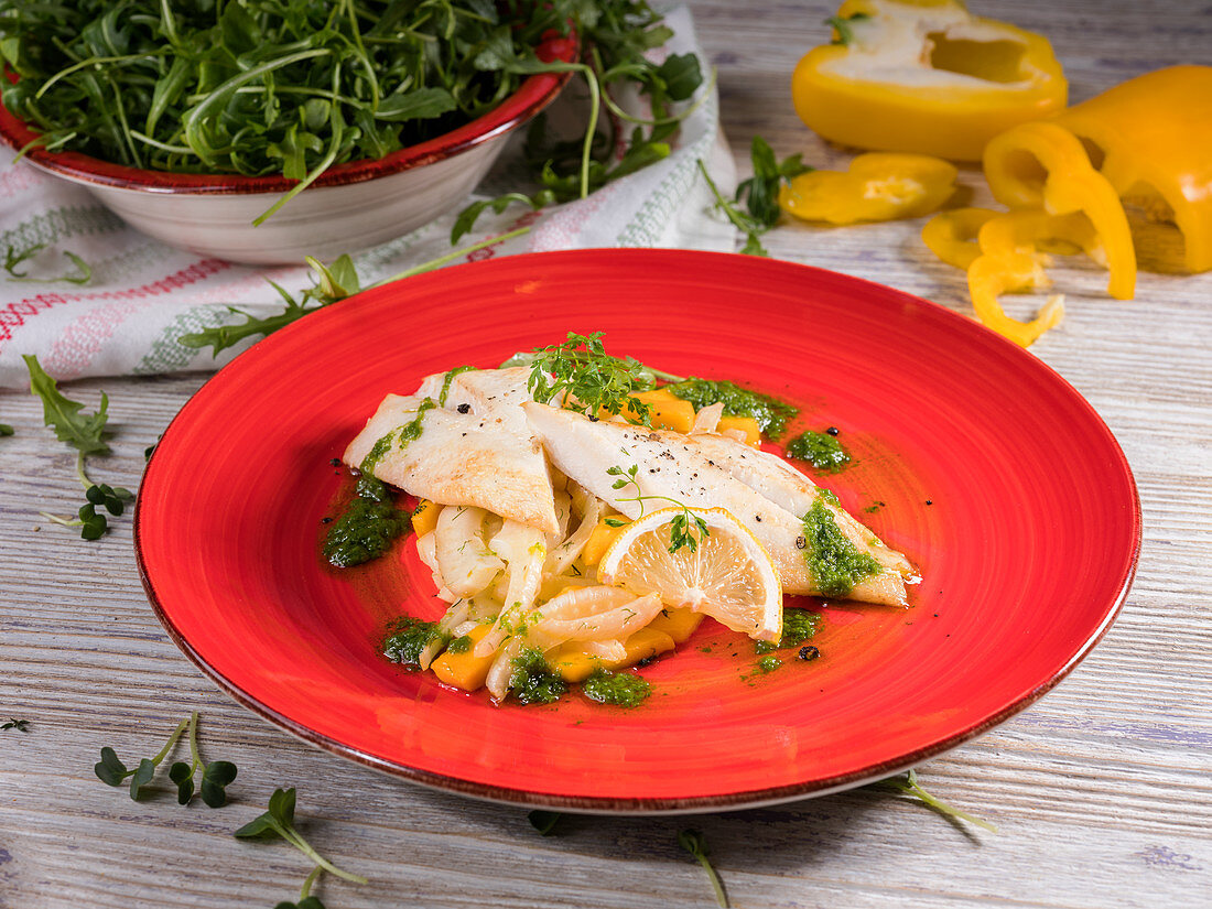 Steamed dory on fennel and mango with rocket pesto