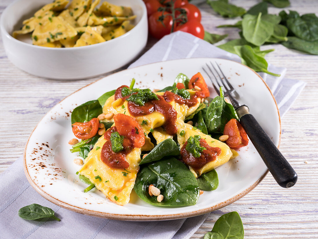 Stuffed tortellini on sauteed spinach with tomato ragout