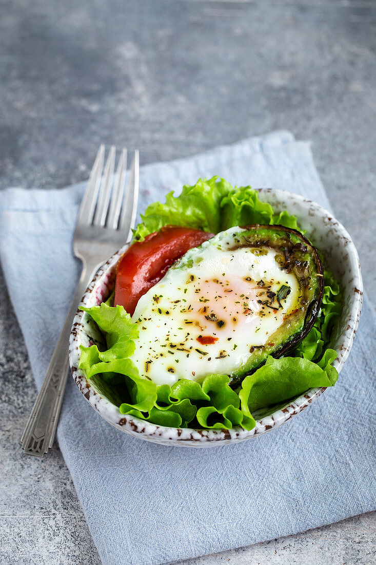 Baked eggs in avocado breakfast