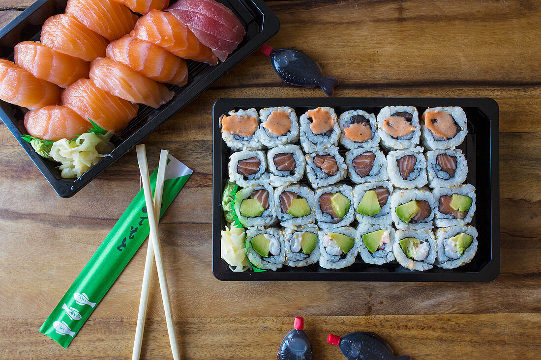 Sushi with chopsticks and soy sauce to take away