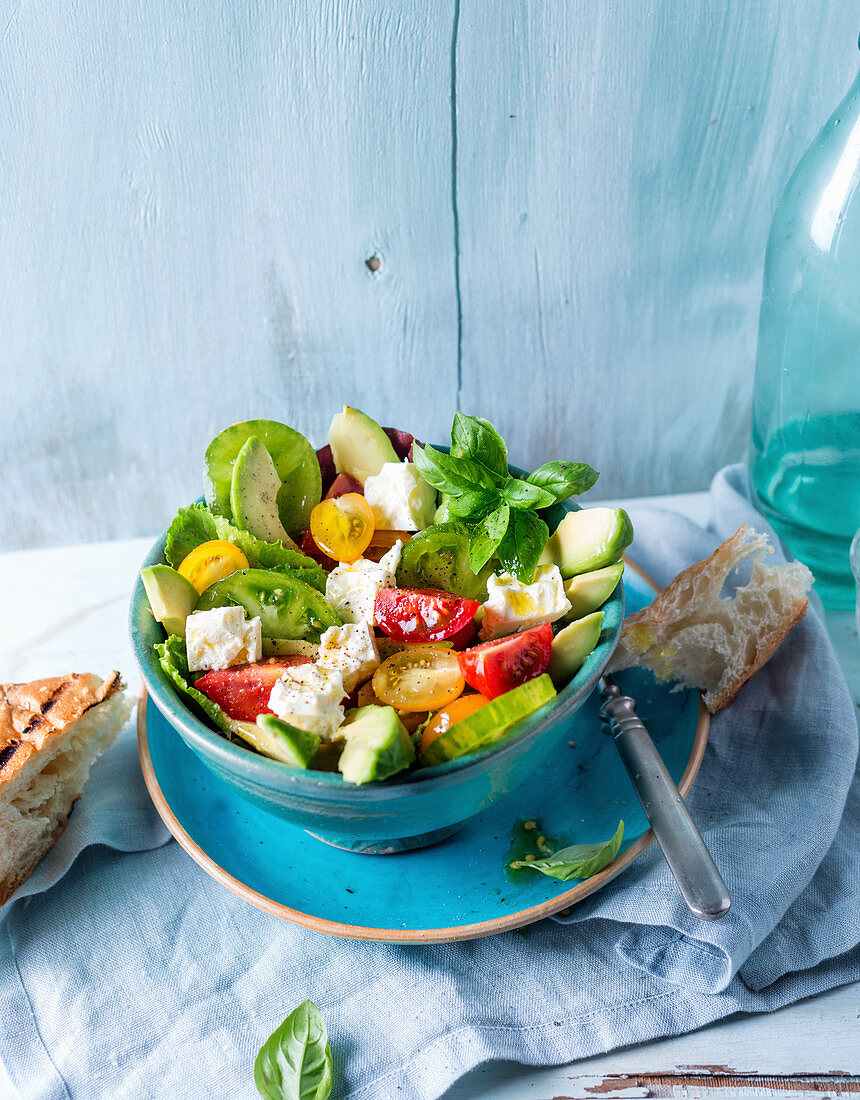 Avocado and tomato salad with basil and grilled flatbread