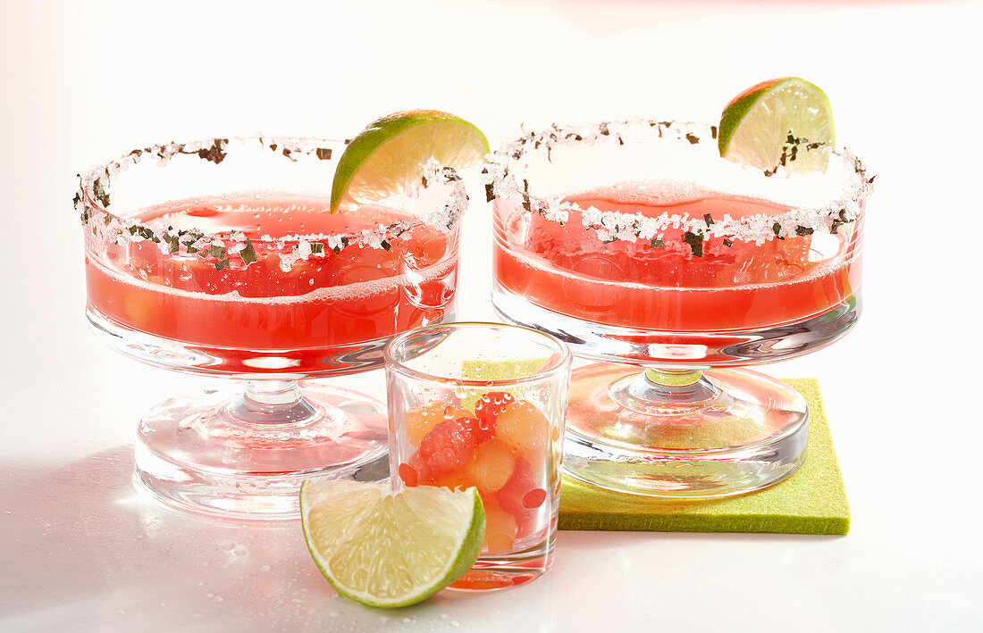 Daiquiris with watermelon, rum, orange liqueur and lime juice in glasses with sugared rims