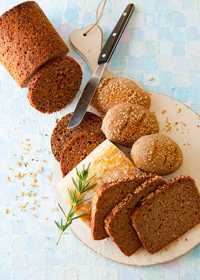 Wholemeal bread, rolls and ciabatta with rosemary sprigs