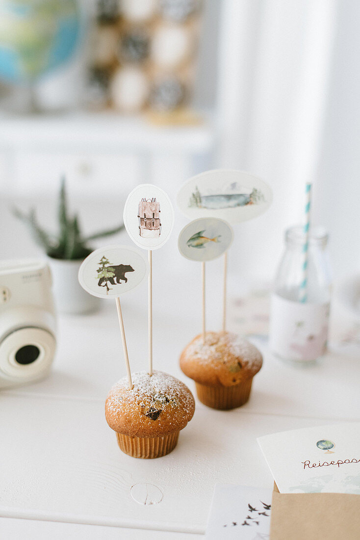 Muffins decorated with handmade decorative skewers for child's birthday party