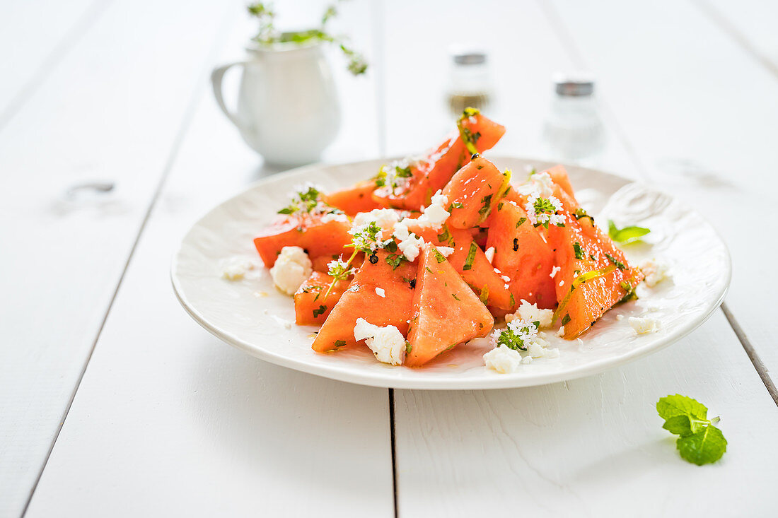 Simple summer salad with watermelon, feta and fresh herbs