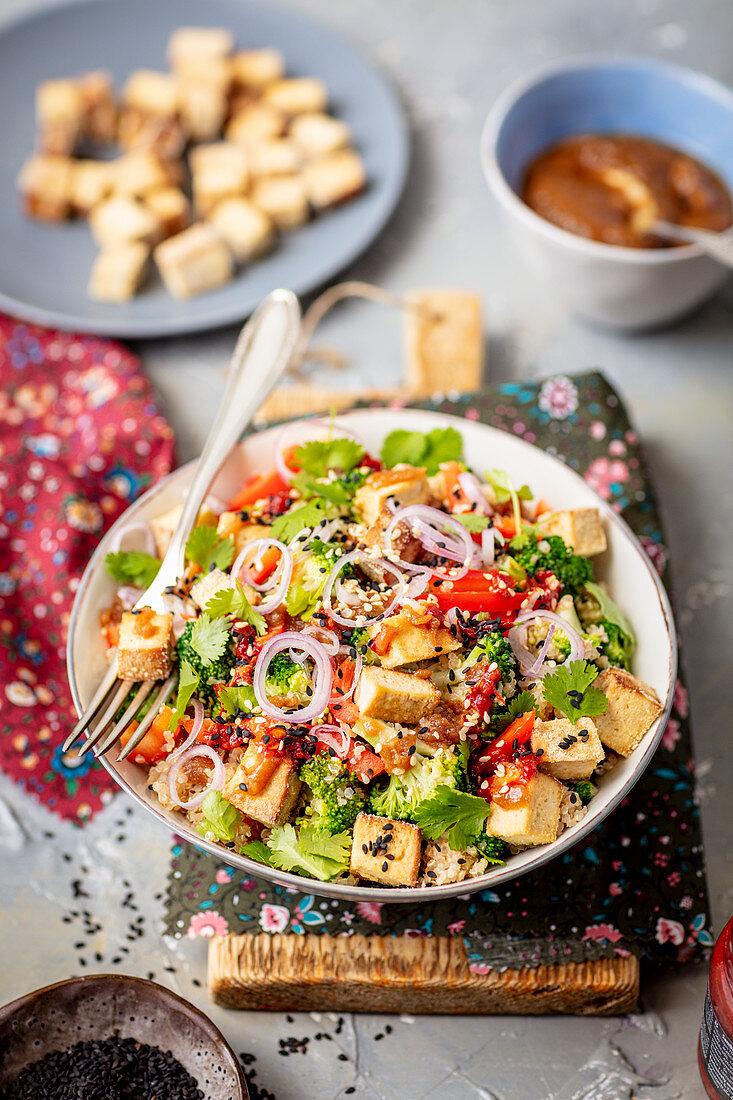 Tofu, quinoa and broccoli salad with peanut butter dressing