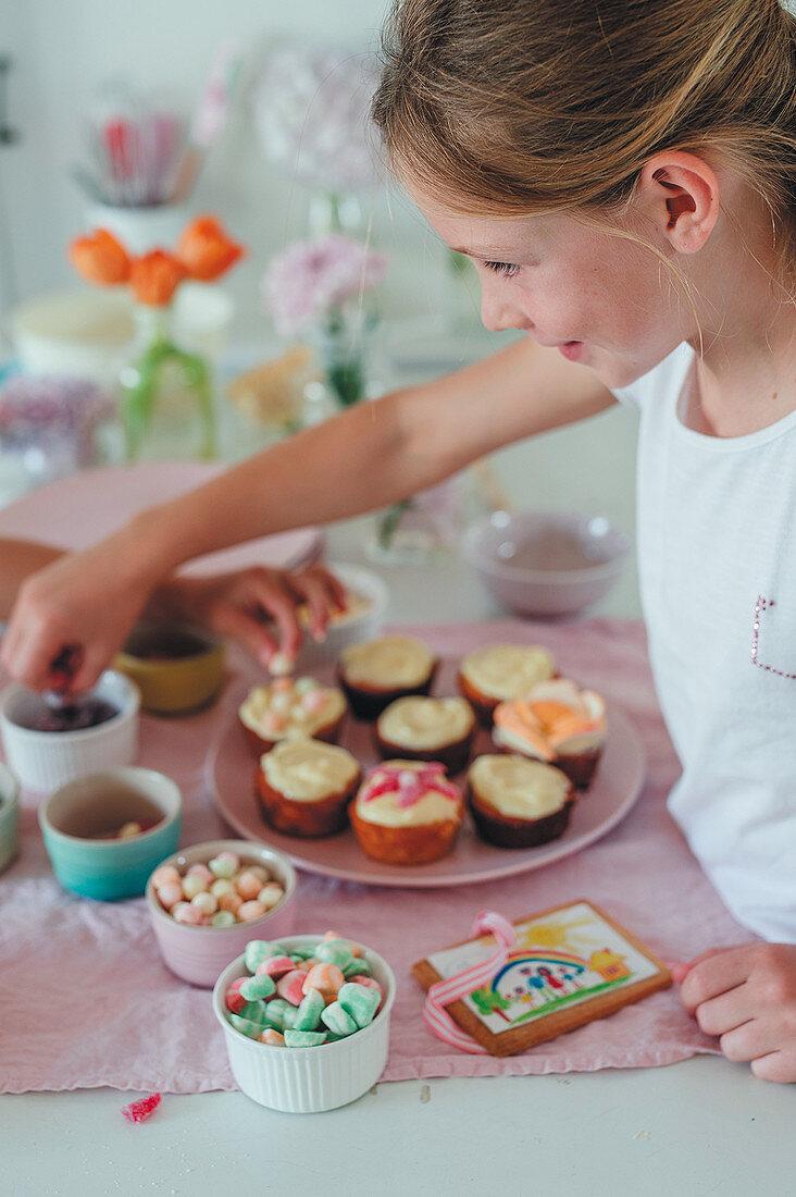 Decorating orange muffins