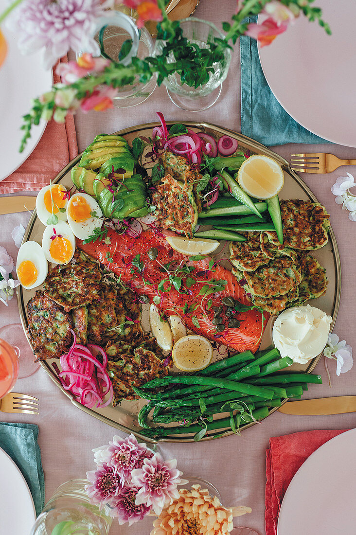 Trout with herb pancakes and vegetables on a Mother's day platter