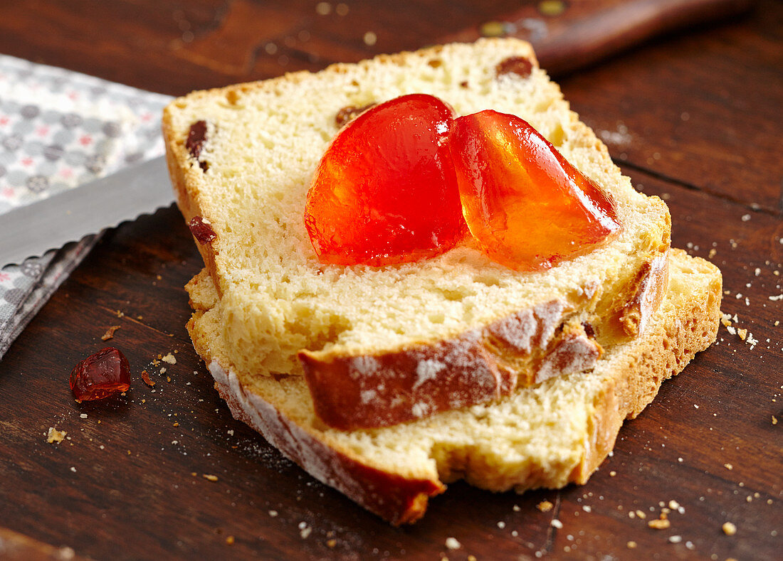 Pink grapefruit jelly on two slices of raisin loaf