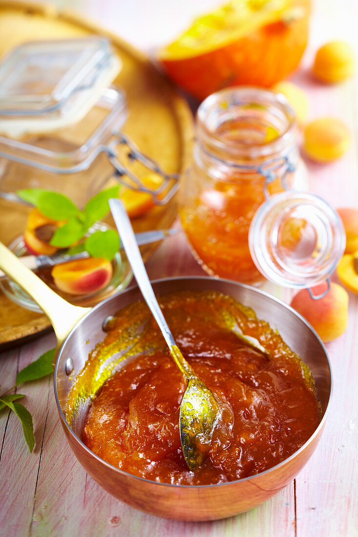 Apricot and pumpkin preserve with rum in a copper pan