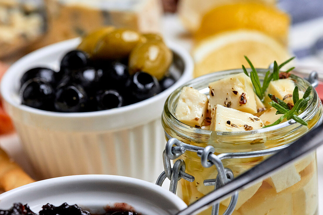 A Mediterranean appetizer platter with olives and pickled cheese