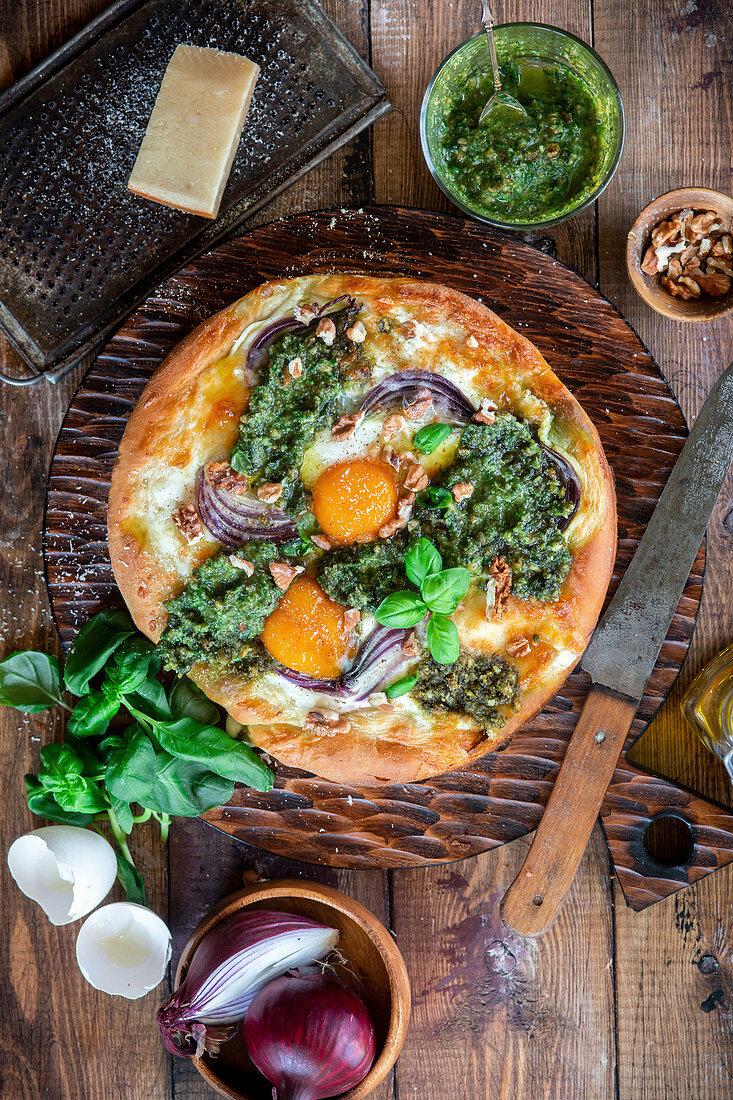 Veggie pizza with pesto and eggs