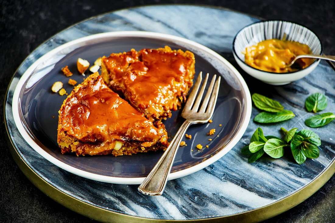 Caramel almond crumble cake slices on plate