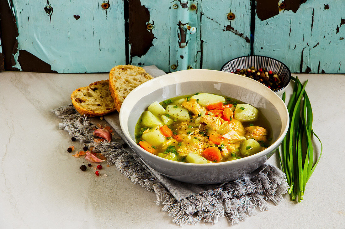 Fish soup with salmon in bowl