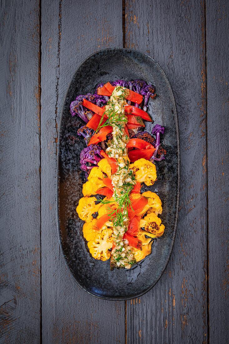 Warm cauliflower salad with marinated salmon and sweet mustard dressing