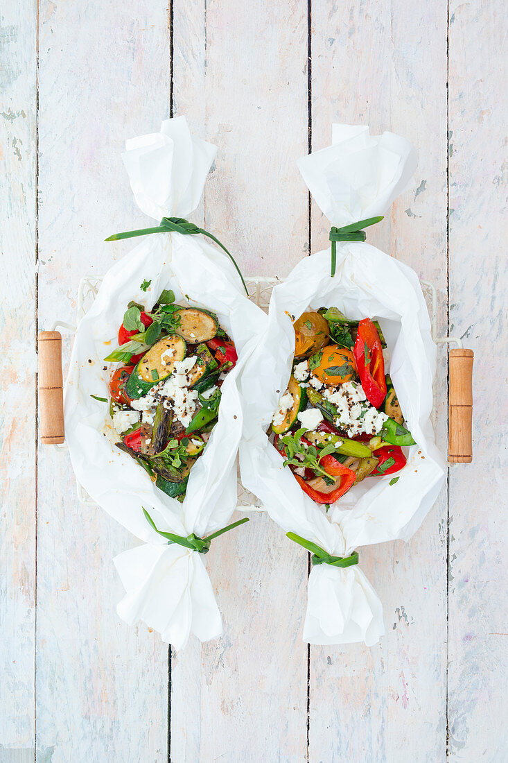 Roasted vegetable parcels with feta cheese and fresh herbs