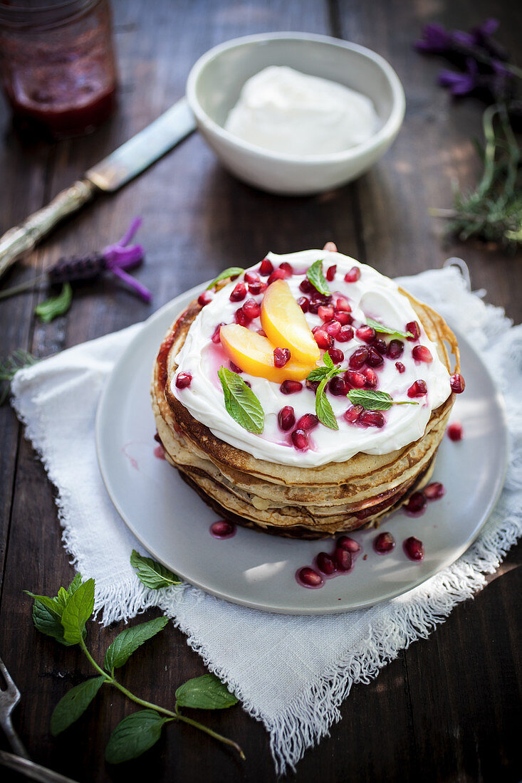 Pancakes with ricotta and pomegranate