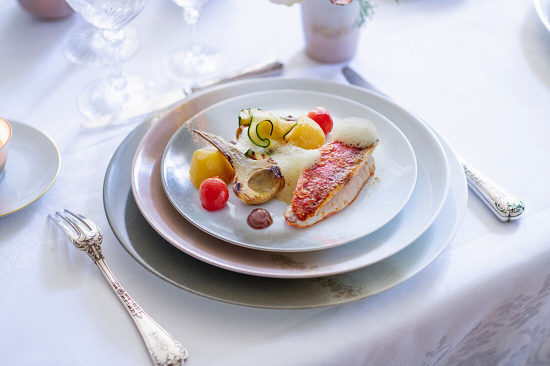 Red mullet with vegetables and foam sauce