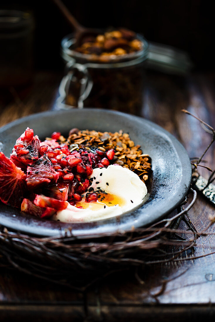 Granola with pomegranate seeds and yoghurt