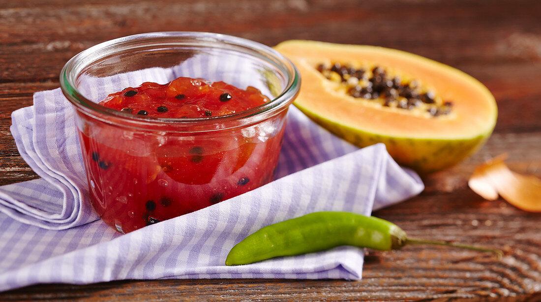 Papaya chutney with orange and green chili in a mason jar
