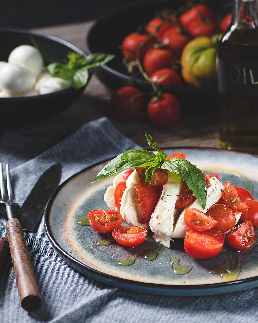 Mozzarella with cherry tomatoes and basil - original caprese salad