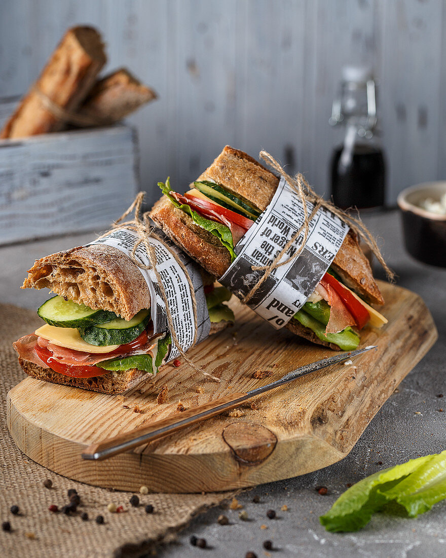 Sandwiches with ham, tomatoes, cucumbers and buckwheat bread