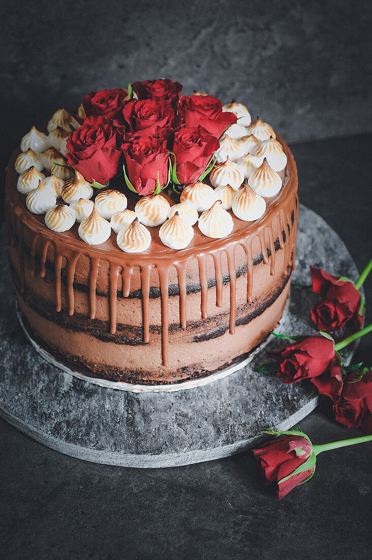 Naked drip cake with chocolate biscuits, chocolate cheesecake and blackberry coulis