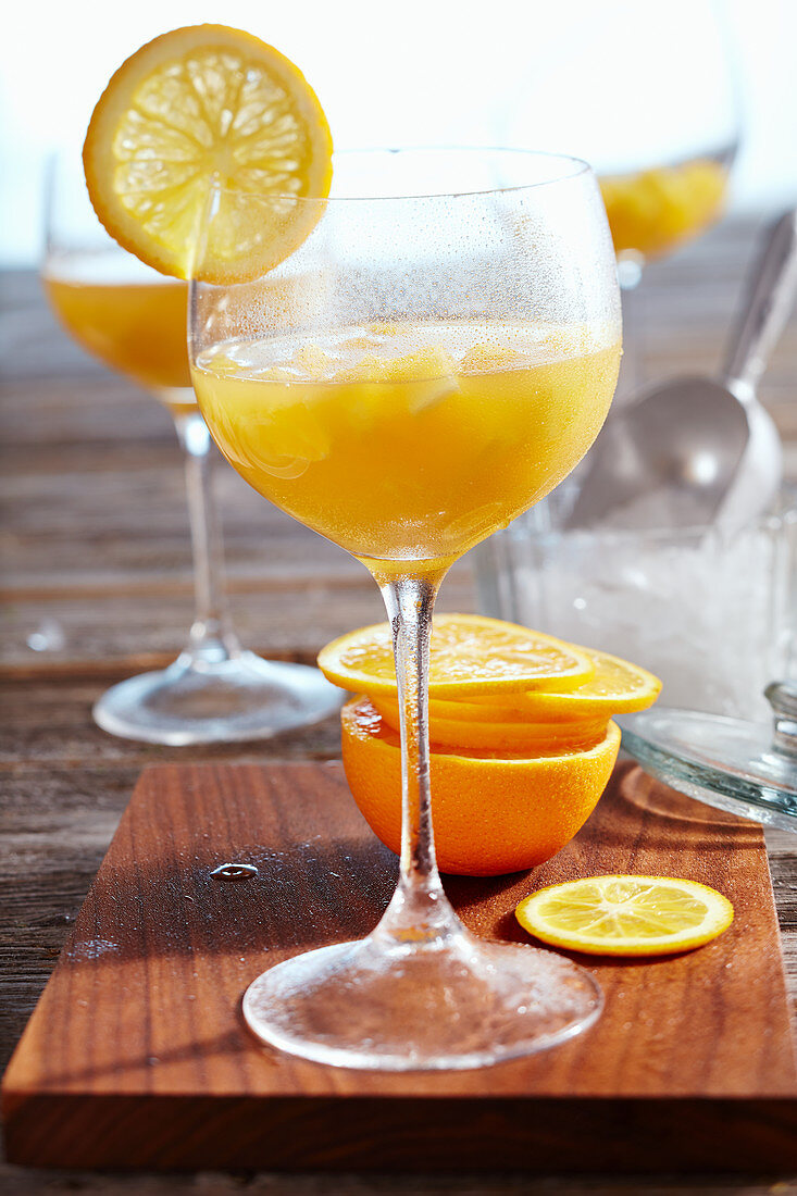Non-alcoholic cocktail (mocktail) with pineapple, orange, lemon and apple