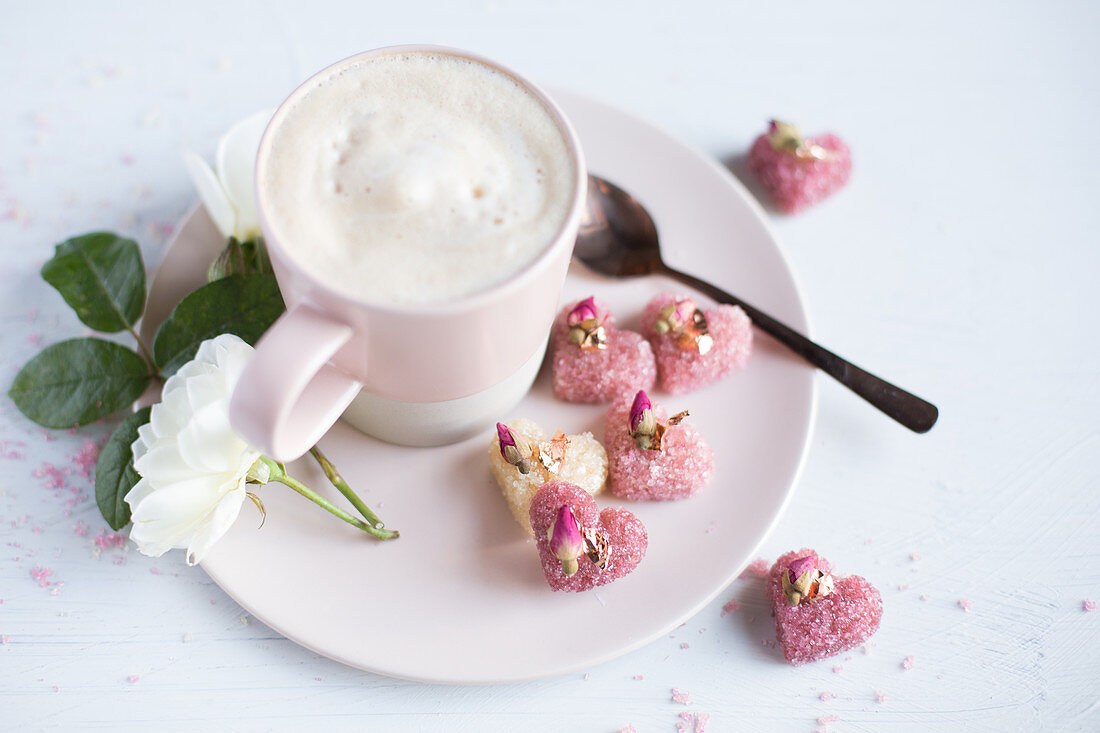 Cappuccino with heart-shaped, rose sugar cubes