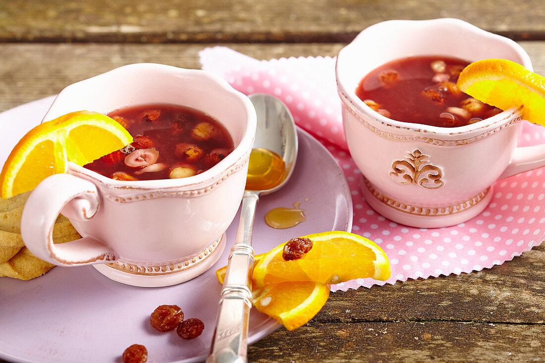 Swedish alcohol-free hazelnut punch with oranges, sultanas, raspberry tea and honey