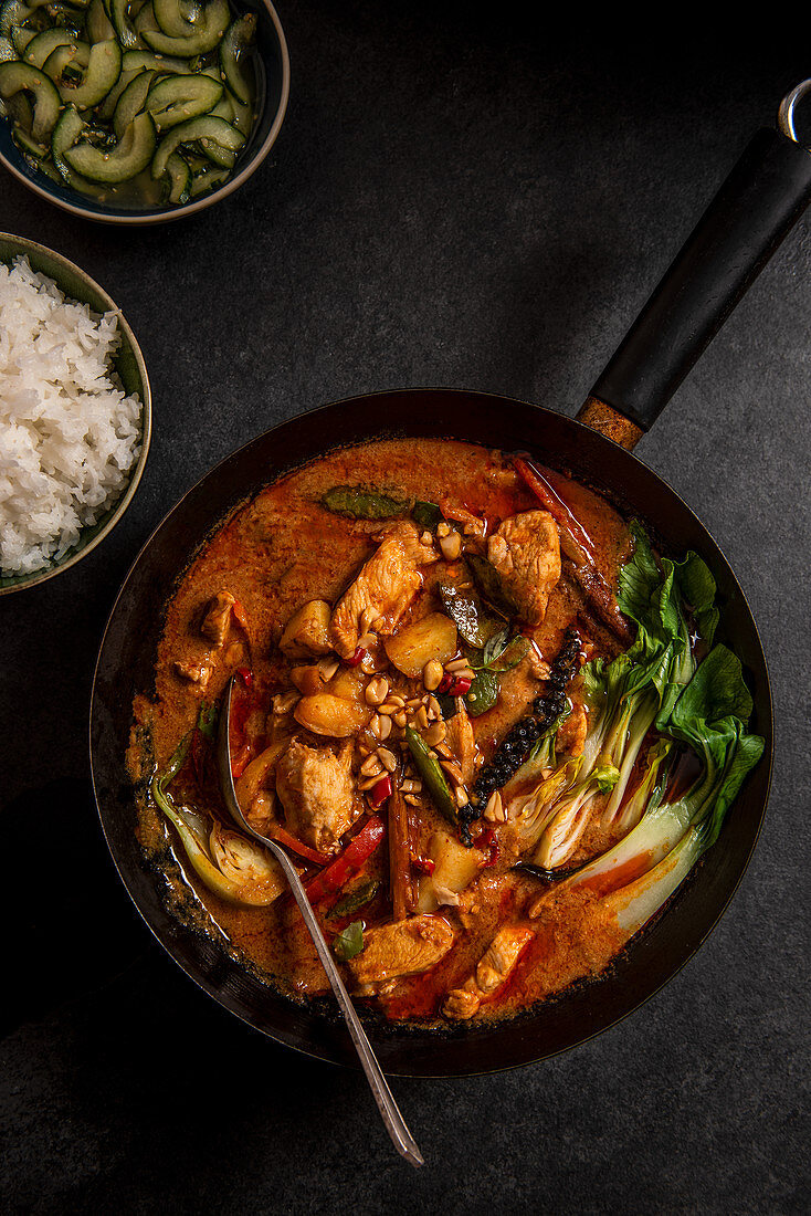 Thai Massaman chicken curry with peanuts, new potatoes, peppers, pakchoi, thai lime cucumber relish and jasmin rice