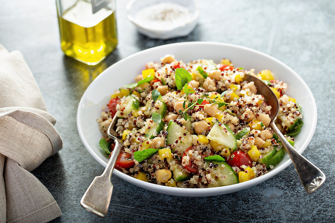 Fresh quinoa tabbouleh salad with tomatoes and cucumbers