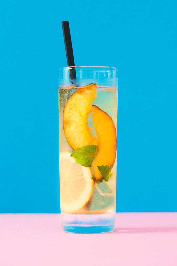 Peach ice tea with lemon and fresh mint.