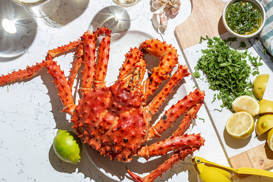 Cooked king crab with white wine and herb lemon sauce