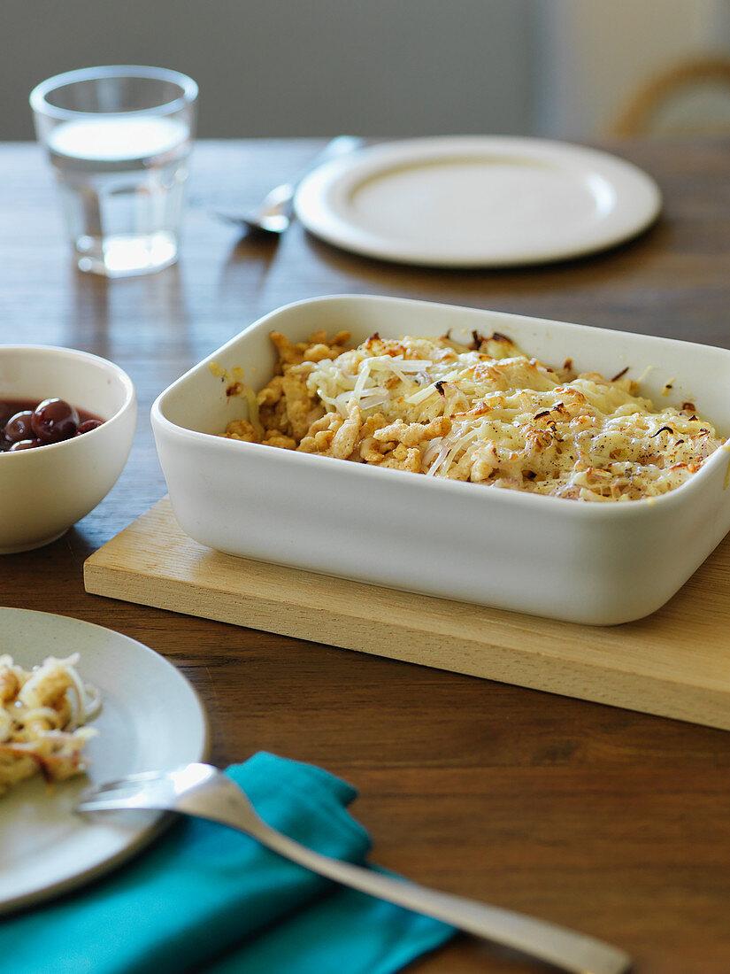 Quark spätzle pasta with cherry compote