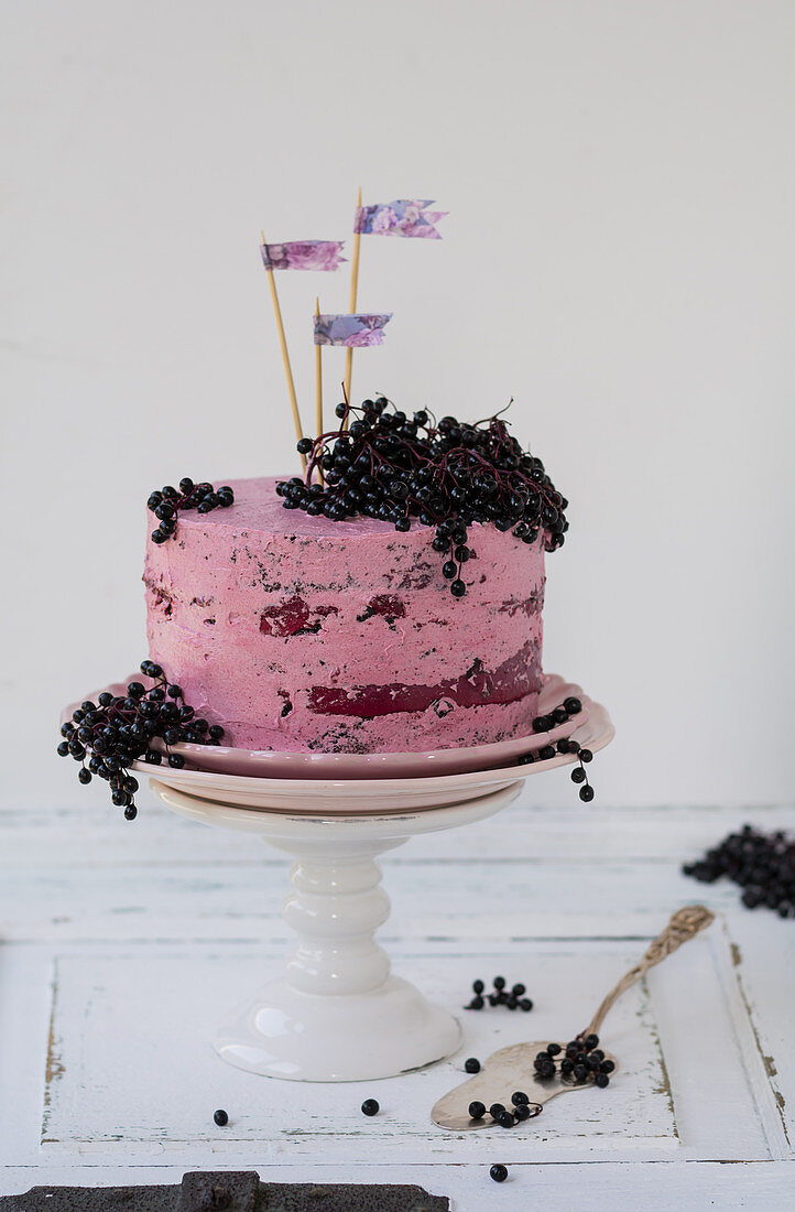 An elderberry cake on a cake stand