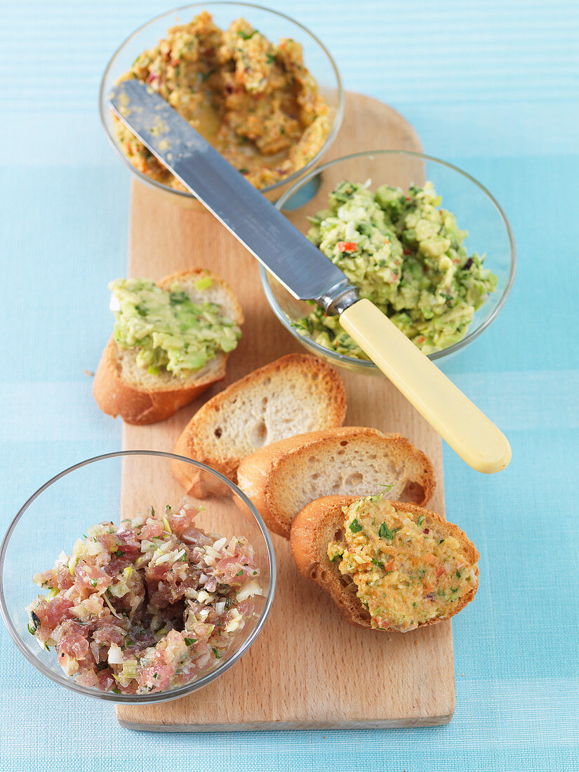 Three spicy spreads and grilled bread