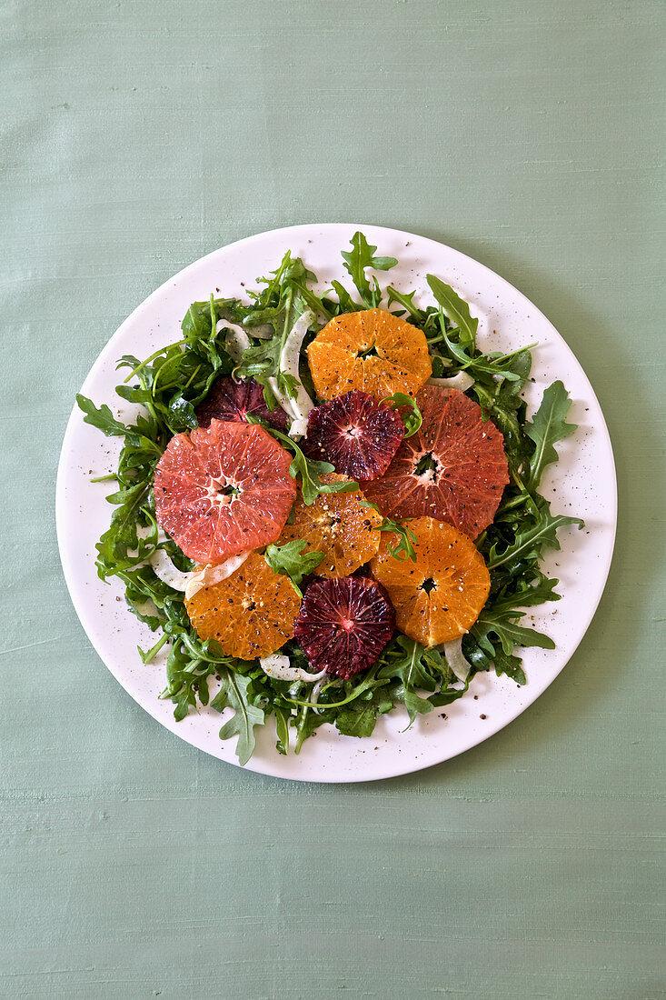 Rocket salad with citrus fruits
