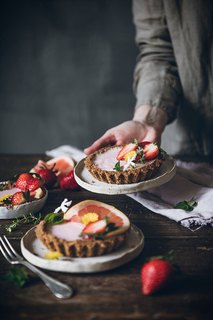 Citrus cake with strawberry on wooden table