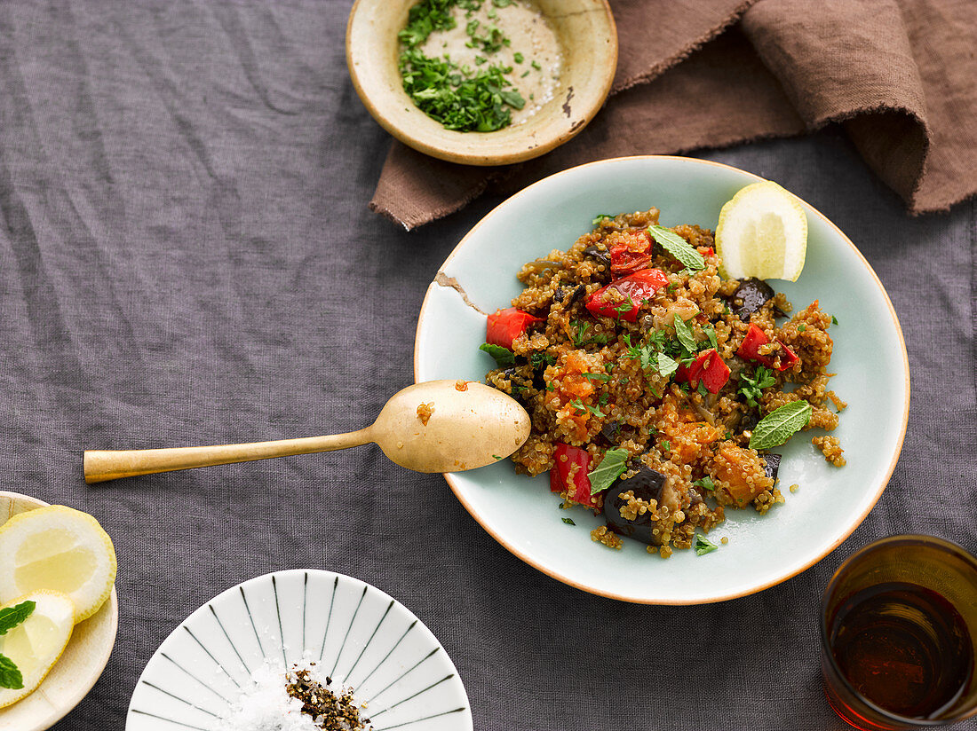 Quinoa with roasted vegetables, rocket and lemon