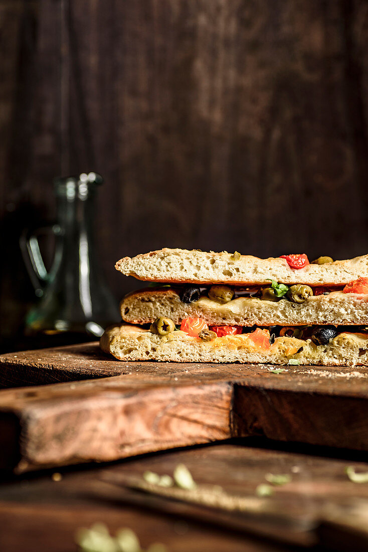 Focaccia with tomatoes, olives basil and oregano