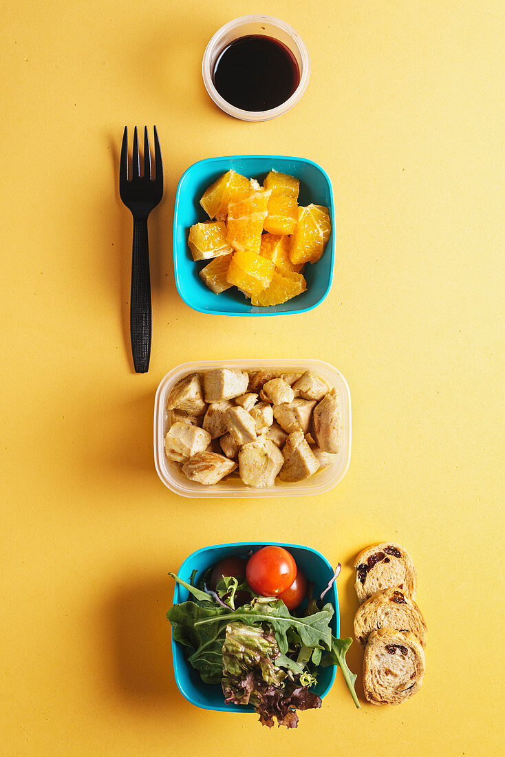 Plastic containers with healthy food and black forkPlastic containers with healthy food for Lunch