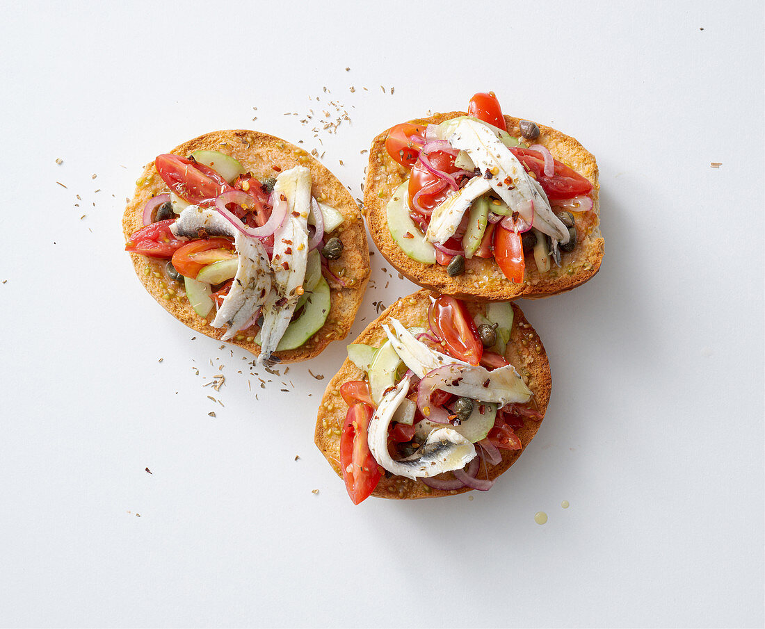 Friselle with marinated anchovies, tomatoes, cucumber and capers