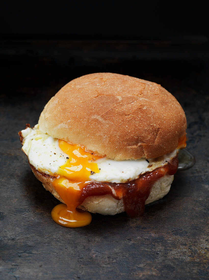 A sandwich with bacon and fried egg