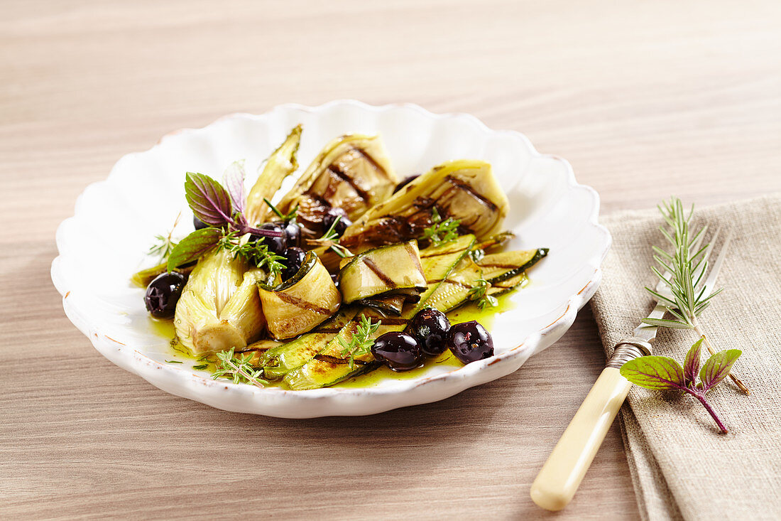 Grilled zucchini and fennel antipasti with olives and fresh herbs