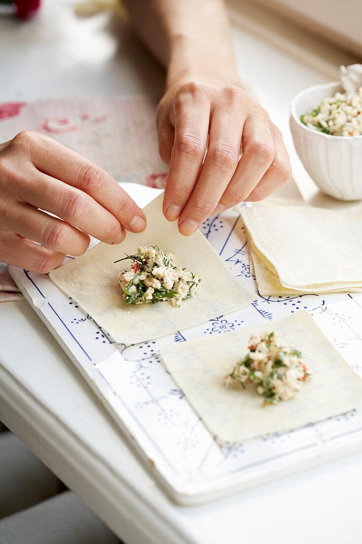 Woman making dumplings