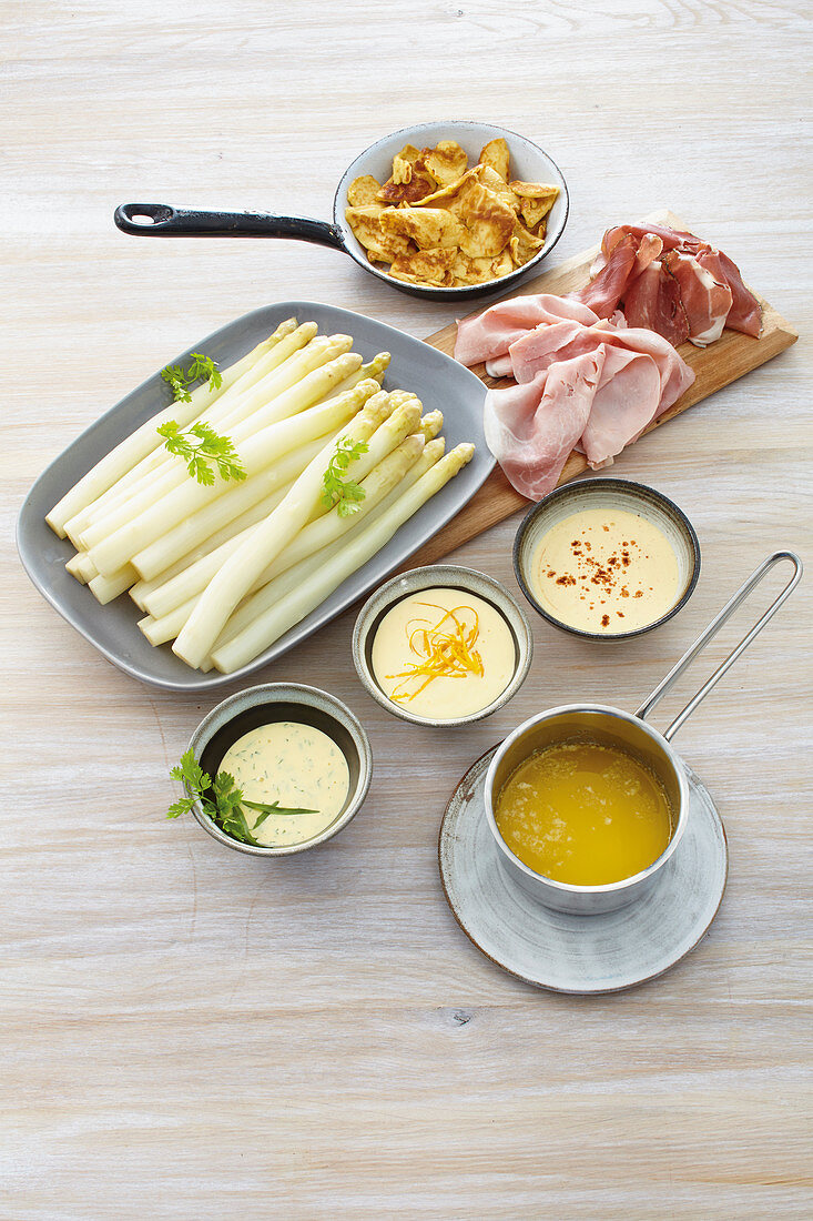 Baden-style asparagus with a trio of sauces and ham