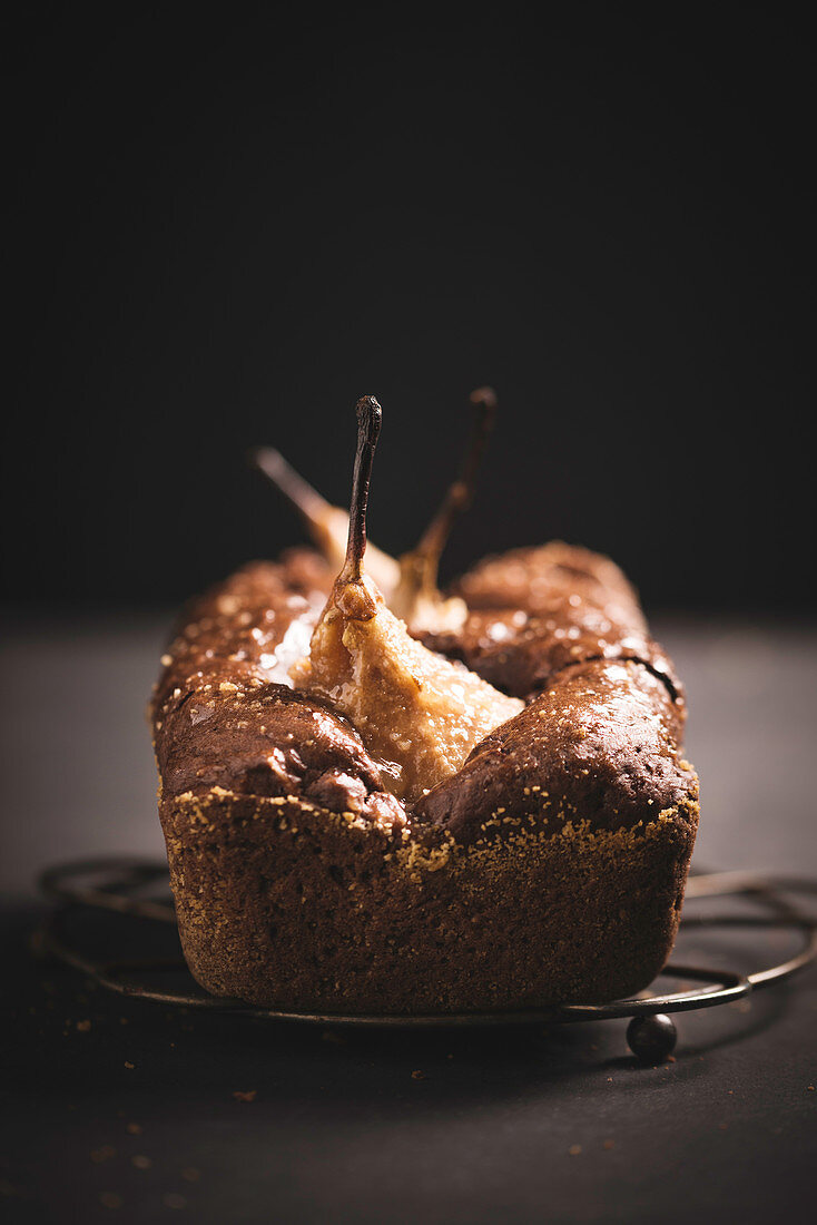 Vegan chocolate cake with baked pears, glazed with elderflower jelly