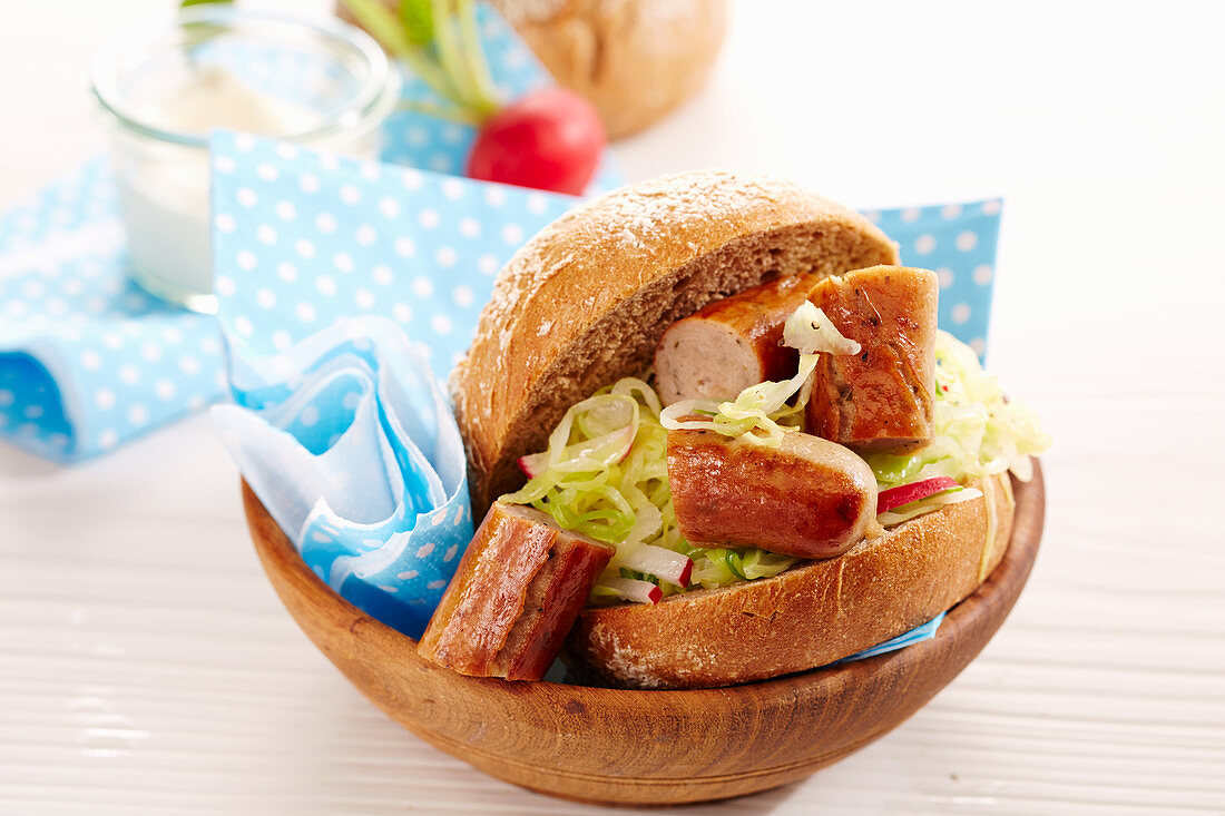 Bratwurst in a wholemeal roll with coleslaw